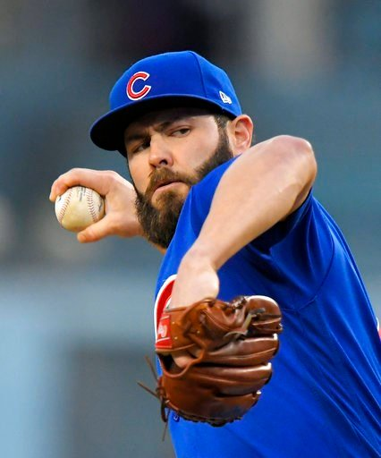 (AP Photo/Mark J. Terrill, File). File-This may 26, 2017, file photo shows Chicago Cubs starting pitcher Jake Arrieta throwing to the plate during the first inning of a baseball game against the Los Angeles Dodgers, in Los Angeles. Two people familiar ...