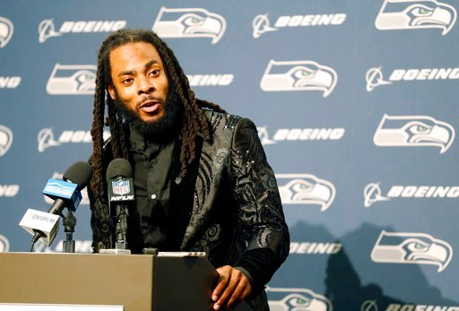 (AP Photo/Stephen Brashear, File). FILE - In this Oct. 29, 2017, file photo, Seattle Seahawks cornerback Richard Sherman talks to reporters during a post-game news conference following an NFL football game against the Houston Texans, in Seattle. Sherma...