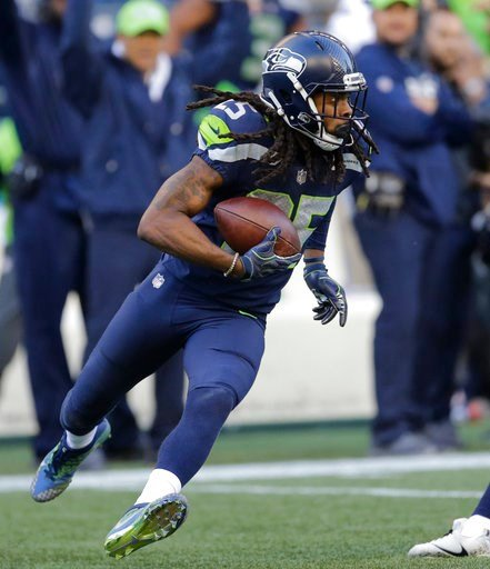 (AP Photo/Stephen Brashear, File). FILE - In this Oct. 29, 2017, file photo, Seattle Seahawks cornerback Richard Sherman (25) runs after he intercepted a pass rom Houston Texans quarterback Deshaun Watson late in the second half of an NFL football game...