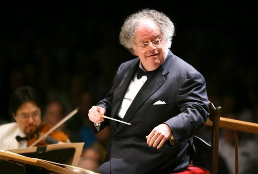 (AP Photo/Michael Dwyer, File). FILE - In this July 7, 2006 file photo, Boston Symphony Orchestra music director James Levine conducts the symphony on its opening night performance at Tanglewood in Lenox, Mass. The Met Opera has fired music director em...