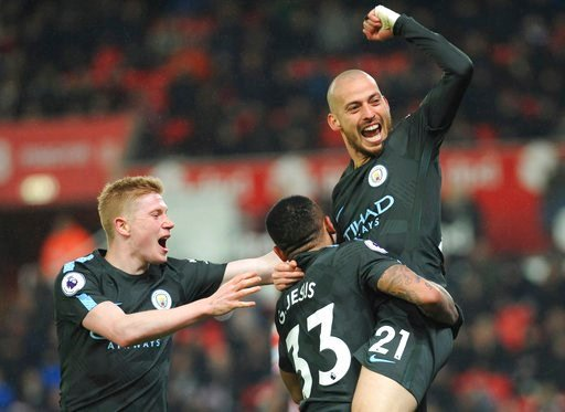 (AP Photo/Rui Vieira). Manchester City's David Silva, right, celebrates scoring his second goal during the English Premier League soccer match between Stoke City and Manchester City at the Bet 365 Stadium in Stoke on Trent, England, Monday, March 12, 2...