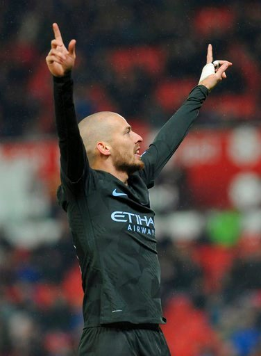 (AP Photo/Rui Vieira). Manchester City's David Silva celebrates after scoring his second goal during the English Premier League soccer match between Stoke City and Manchester City at the Bet 365 Stadium in Stoke on Trent, England, Monday, March 12, 2018.