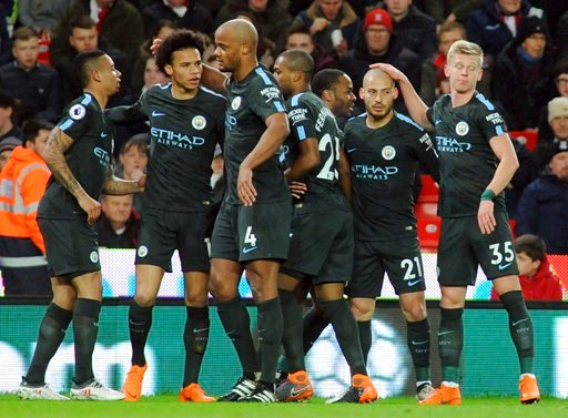 (AP Photo/Rui Vieira). Manchester City's David Silva, second right, celebrates with teammates after scoring his side's first goal during the English Premier League soccer match between Stoke City and Manchester City at the Bet 365 Stadium in Stoke on T...