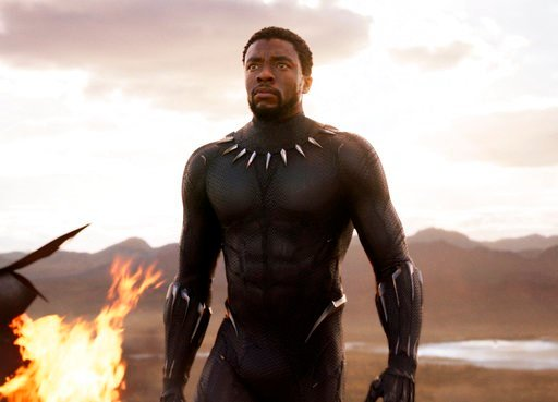"(Marvel Studios/Disney via AP). This image released by Disney and Marvel Studios' shows Chadwick Boseman in a scene from ""Black Panther."""