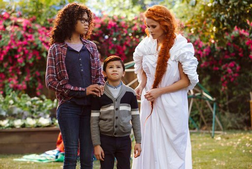 """(Atsushi Nishijima/Disney via AP). This image released by Disney shows Storm Reid, from left, Deric McCabe and Reese Witherspoon in a scene from """"A Wrinkle In Time."""""""