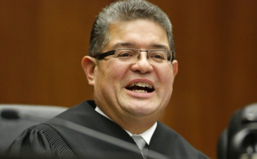 (AP Photo/M. Spencer Green, File). FILE - In this Nov. 25, 2013 file photo, Chief U.S. District Judge Ruben Castillo speaks from the bench in Chicago. Castillo is slated to issue a first-in-the-nation ruling Monday, March 12, 2018, about whether law en...