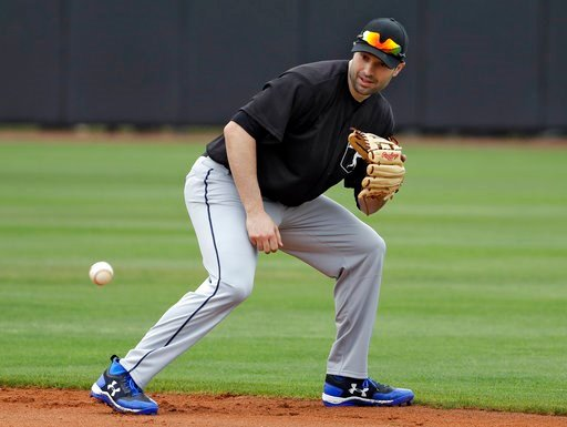(AP Photo/Chris O'Meara, File). FILE - In this Feb. 27, 2018, file photo, Major League Baseball free agent second baseman Neil Walker fields a ground ball during infield drills before a scrimmage game  in Bradenton, Fla. A person familiar with the nego...