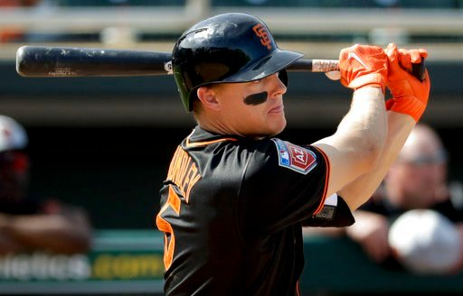 (AP Photo/Chris Carlson). San Francisco Giants' Nick Hundley watches his three-RBI double against the Oakland Athletics during the fifth inning of a spring baseball game in Mesa, Ariz., Monday, March 12, 2018.