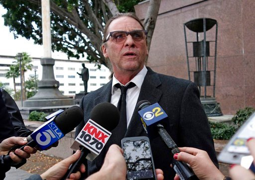 (AP Photo/Brian Melley, file). In this Jan. 8, 2018, file photo, Michael Channels speaks to reporters after a hearing in Los Angeles Superior Court in Los Angeles.