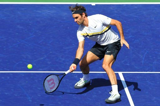 (AP Photo/Crystal Chatham). Roger Federer returns a shot to Filip Krajinovic during the third round of the BNP Paribas Open tennis tournament at the Indian Wells Tennis Garden in Indian Wells, Calif., Monday, March 12, 2018.