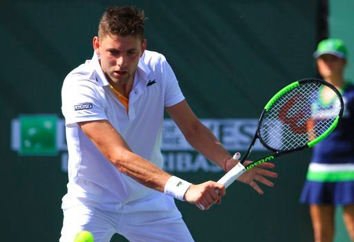 (AP Photo/Crystal Chatham). Filip Krajinovic returns a shot to Roger Federer during the third round of the BNP Paribas Open tennis tournament at the Indian Wells Tennis Garden in Indian Wells, Calif., Monday, March 12, 2018.