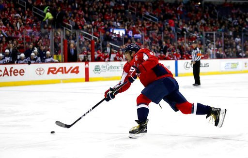 (AP Photo/Alex Brandon). Washington Capitals left wing Alex Ovechkin shoots for a goal in the first period of an NHL hockey game against the Winnipeg Jets, Monday, March 12, 2018, in Washington.