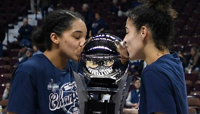 Connecticut's Gabby Williams and Kia Nurse, right, kiss the American Athletic Conference championship trophy. (AP Photo/Jessica Hill)