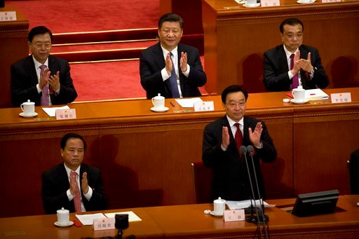 (AP Photo/Mark Schiefelbein). In this Sunday, March 11, 2018, photo, Chinese President Xi Jinping, top center, applauds after hearing the results of a vote on a constitutional amendment during a plenary session of China's National People's Congress (NP...