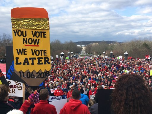 (AP Phiti/Adam Beam). More than a thousand teachers and other public workers rally at the Kentucky Capitol to demonstrate against proposed changes to the state's pension system on Monday, March 12, 2018, in Frankfort, Ky.