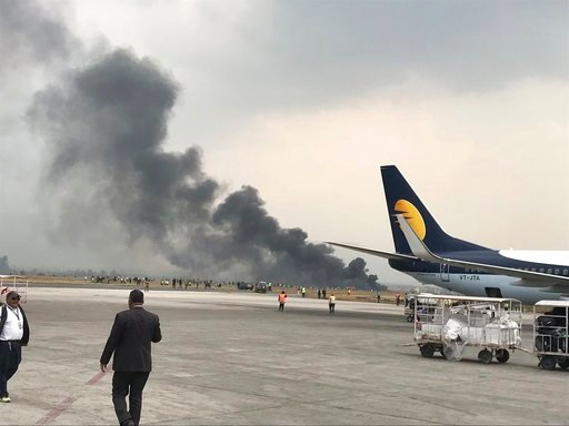 (Bishnu Sapkota via AP). Smoke rises after a passenger plane from Bangladesh crashed at the airport in Kathmandu, Nepal, Monday, March 12, 2018. A passenger plane carrying 71 people from Bangladesh crashed and burst into flames as it landed Monday in K...