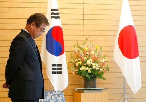 (Kim Kyung-Hoon/Pool Photo via AP). South Korea's National Intelligence Service Chief Suh Hoon waits for the arrival of Japanese Prime Minister Shinzo Abe for a meeting in Tokyo Tuesday, March 13, 2018.