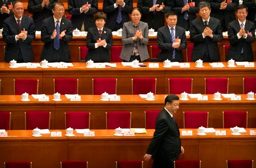 (AP Photo/Mark Schiefelbein). Chinese President Xi Jinping arrives for a plenary session of China's National People's Congress (NPC) in Beijing, Tuesday, March 13, 2018. China's rubber-stamp lawmakers on Sunday passed a historic constitutional amendmen...