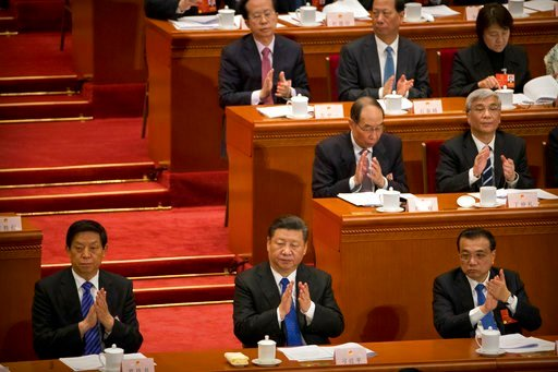 (AP Photo/Mark Schiefelbein). Chinese President Xi Jinping, center, applauds during a plenary session of China's National People's Congress (NPC) in Beijing, Tuesday, March 13, 2018. China's rubber-stamp lawmakers on Sunday passed a historic constituti...