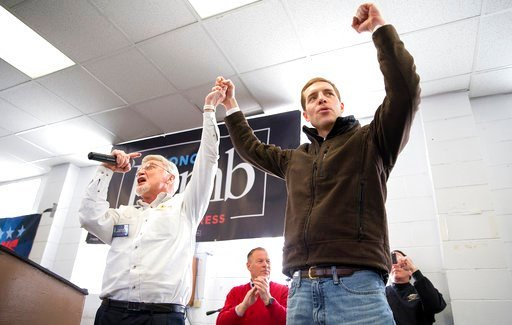 (Antonella Crescimbeni/Pittsburgh Post-Gazette via AP). Cecil Roberts, president of the United Mine Workers, left, lifts up Democratic candidate Conor Lamb's hand as the crowd erupts in cheers and chants during a rally, Sunday, March 11, 2018.