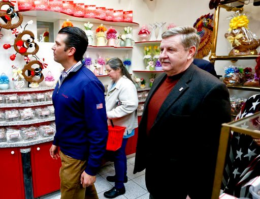 (AP Photo/Keith Srakocic). Republican Rick Saccone, right, and Donald Trump Jr., tour Sarris Candies during a campaign stop, Monday, March 12, 2018, in Canonsburg, Pa.