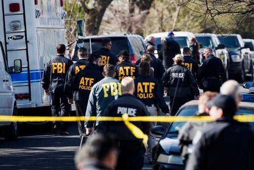 (Ricardo B. Brazziell/Austin American-Statesman via AP). Authorities work on the scene of an explosion in Austin on Monday, March 12, 2018.