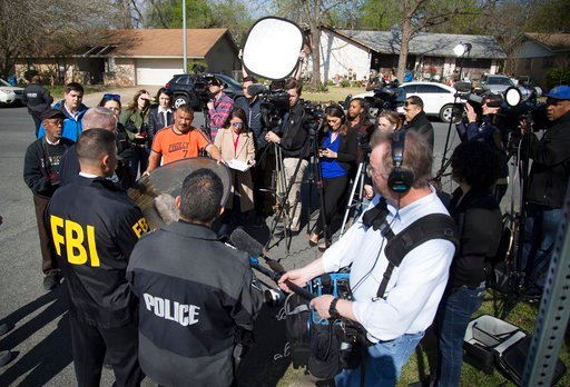 (Ricardo B. Brazziell/Austin American-Statesman via AP). Authorities speak to the media after multiple explosions in Austin on Monday, March 12, 2018.