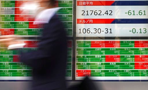 (AP Photo/Eugene Hoshiko). A man walks past an electronic stock board showing Japan's Nikkei 225 index at a securities firm in Tokyo Tuesday, March 13, 2018. Shares were mixed in Asia on Tuesday following a lackluster day on Wall Street. Investors are ...