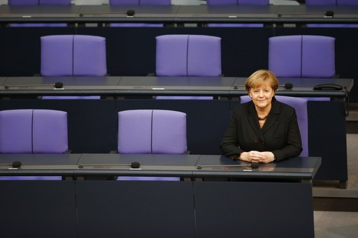 (AP Photo/Michael Sohn, file). FILE - In this Dec. 17, 2013 file photo German Chancellor Angela Merkel sits smiling at the government bench after being reelected during a meeting of the German federal parliament, Bundestag, in Berlin, Germany. On Wedne...