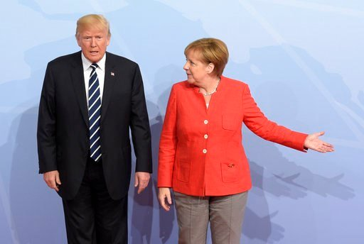 (AP Photo/Jens Meyer, file). FILE - In this July 7, 2017 file photo U.S. President Donald Trump, left, is welcomed by German Chancellor Angela Merkel on the first day of the G-20 summit in Hamburg, northern Germany. On Wednesday, March 14, 2018 Angela ...