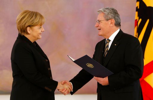(AP Photo/Ferdinand Ostrop, file). FILE - In this Dec. 17, 2013 file photo German President Joachim Gauck, rights, hands over the letter of appointment to newly reelected German Chancellor Angela Merkel in Berlin. On Wednesday, March 14, 2018 Angela Me...