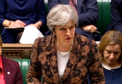 "(PA via AP). Britain's Prime Minister Theresa May speaks in the House of Commons in London, Monday, March 12, 2018. British Prime Minister Theresa May says her government has concluded it is ""highly likely"" Russia is responsible for the poisoning of an..."