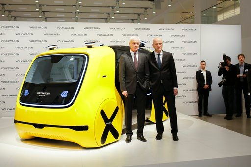 (AP Photo/Markus Schreiber). VW group CEO Matthias Mueller, left, and CFO Frank Witter, right, pose in front of a self driving concept car prior to the annual media conference of the Volkswagen group, in Berlin, Germany, Tuesday, March 13, 2018.