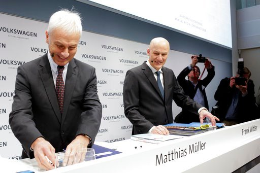 (AP Photo/Markus Schreiber). VW group CEO Matthias Mueller, left, and CFO Frank Witter, right, arrive for the annual media conference of the Volkswagen group, in Berlin, Germany, Tuesday, March 13, 2018.