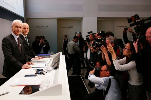 (AP Photo/Markus Schreiber). VW group CEO Matthias Mueller, left, and CFO Frank Witter, second from left, arrive for the annual media conference of the Volkswagen group, in Berlin, Germany, Tuesday, March 13, 2018.