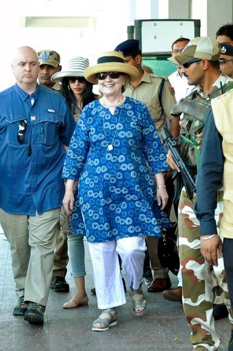 (AP Photo/Sunil Verma). Former U.S. Secretary of State Hillary Clinton, center, comes out of the Jodhpur airport upoon her arrival in Jodhpur, Rajasthan state, India, Tuesday, March 13, 2018.