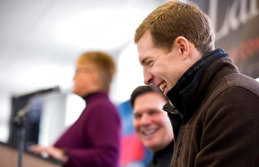 (Antonella Crescimbeni/Pittsburgh Post-Gazette via AP). Democratic candidate Conor Lamb laughs during a rally with the United Mine Workers of America, Sunday, March 11, 2018, at the Greene County Fairgrounds in Waynesburg, Pa. Lamb is running against s...