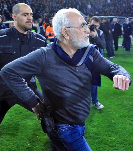 (InTime Sports via AP). PAOK owner, businessman Ivan Savvidis invades into the pitch during a Greek League soccer match between PAOK and AEK Athens in the northern Greek city of Thessaloniki, Sunday, March 11, 2018. Savvidis came on the field twice and...