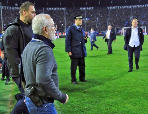 (InTime Sports via AP). PAOK owner, businessman Ivan Savvidis invades into the pitch during the Greek League soccer match between PAOK and AEK Athens in the northern Greek city of Thessaloniki, Sunday, March 11, 2018. Savvidis invaded the pitch twice. ...