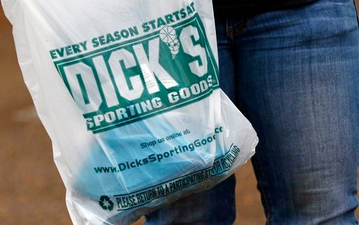 (AP Photo/Rogelio V. Solis, File). FILE- In this March 1, 2018, file photo a customer carries her purchase from a Dick's Sporting Goods store in Madison, Miss. Dick's Sporting Goods, Inc. reports earnings Tuesday, March 13, 2018.
