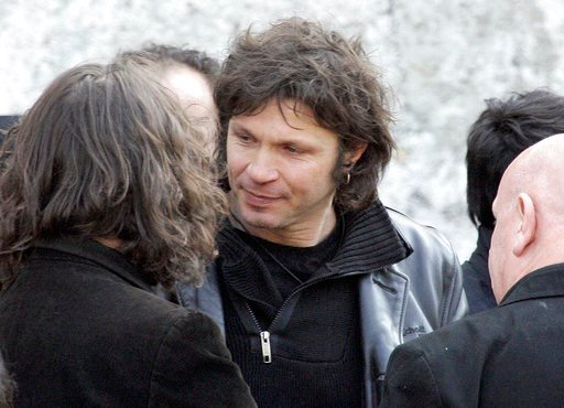 (AP Photo/Francois Mori). FILE - In this March 20 2009 file photo, French rock singer Bertrand Cantat, center, attends the funeral ceremony of French rock singer Alain Bashung in Paris. Cantat, who was convicted of killing his girlfriend 15 years ago, ...