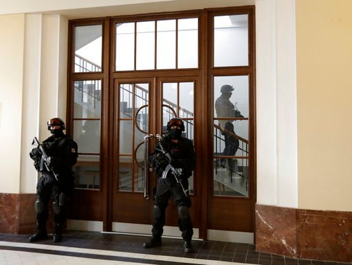 (AP Photo/Petr David Josek, File). FILE - In this file photo taken on Friday, Nov. 24, 2017, in Prague, Czech Republic, a prison guards walks outside a courtroom during an appeal by Yevgeniy Nikulin from Russia who faces charges of hacking computers of...