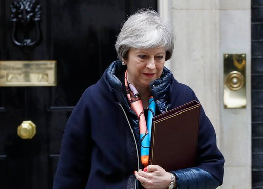 (AP Photo/Kirsty Wigglesworth). Britain's Prime Minister Theresa May leaves Downing Street to attend parliament for the Chancellors Spring Statement, in London, Tuesday, March 13, 2018. May said on Monday that Russian ex-spy Sergei Skripal and his daug...