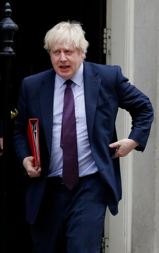 (AP Photo/Kirsty Wigglesworth). Britain's Foreign Secretary Boris Johnson leaves 10 Downing Street after attending a cabinet meeting, in London, Tuesday, March 13, 2018.