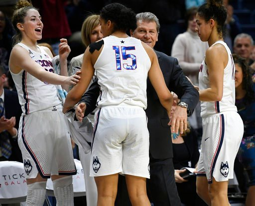 (AP Photo/Jessica Hill, File). FILE - In this Feb. 26, 2018, file photo, Connecticut head coach Geno Auriemma, center, and player Katie Lou Samuelson, left, smile as seniors Gabby Williams, center, and Kia Nurse leave play for the final time in regular...