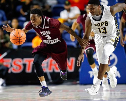 (AP Photo/Eric Christian Smith). Texas Southern guard Demontrae Jefferson (3) and Arkansas-Pine Bluff guard Joe'Randle Toliver (13) chase the ball during the second half of an NCAA college basketball game in the championship of the Southwestern Athleti...