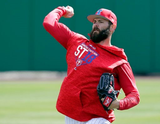 (AP Photo/John Raoux). Philadelphia Phillies pitcher Jake Arrieta throws during a work out before a spring baseball exhibition game against the Tampa Bay Rays, Tuesday, March 13, 2018, in Clearwater, Fla.