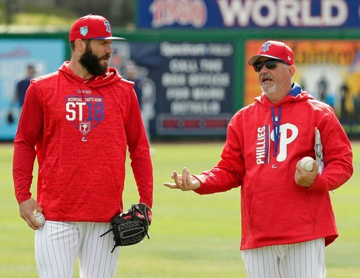 (AP Photo/John Raoux). Philadelphia Phillies pitcher Jake Arrieta, left, talks with pitching coach Rick Krannitz during a work out before a spring baseball exhibition game against the Tampa Bay Rays, Tuesday,March 13, 2018, in Clearwater, Fla.