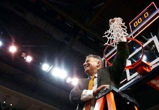 (AP Photo/Brynn Anderson). Auburn head coach Bruce Pearl cuts down the net after an NCAA college basketball game against South Carolina, Saturday, March 3, 2018, in Auburn, Ala.