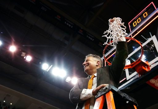 (AP Photo/Brynn Anderson). Auburn head coach Bruce Pearl cuts down the net after an NCAA college basketball game against South Carolina, Saturday, March 3, 2018, in Auburn, Ala.